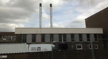 Industrial steel chimneys with black tops